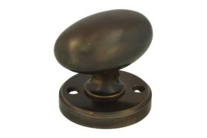 Turnable oval door knob antique brass with round rosette