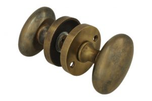 Pair of knobs oval antique brass with round rosette
